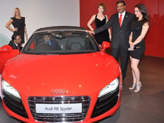 Audi Bhopal showroom opening - Mr. Gaurav Anand, Managing Director, Audi Bhopal (Anand Cars Private Ltd) sitting insise Audi R8 Sypder and Nauheed Cyrusi