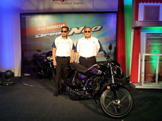 Honda official posing with the Dream Neo at launch