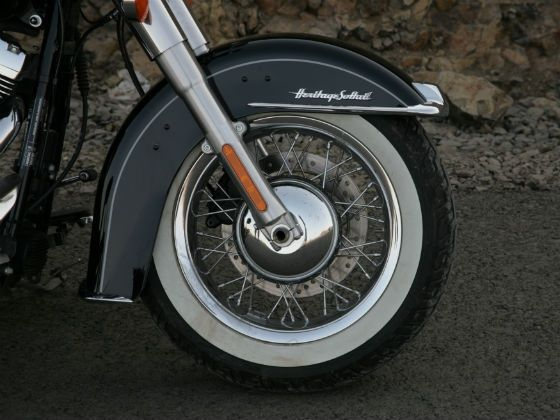White side-walled tyres on chrome finished spoke rim