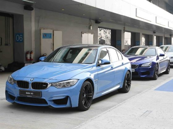 BMW M4 lined up in the pit lane